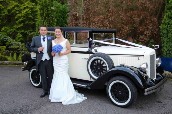 Vintage Wedding Car Hire - Bride and Groom with an Ivory and Black Regent