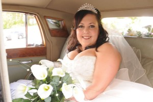 Classic Wedding Car Hire - Happy bride inside Daimler Landaulette