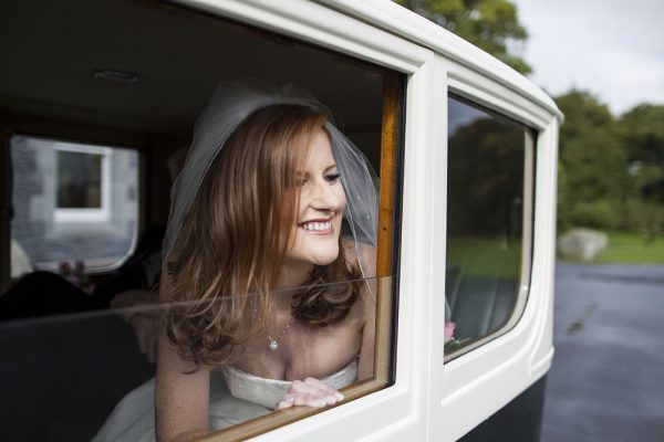 Vintage Wedding Car Hire - Happy bride inside a vintage Rolls Royce